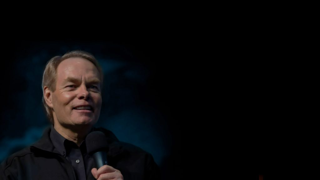Andrew Wommack Speaking into Microphone